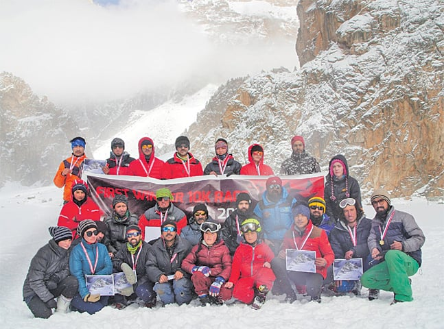ORGANISERS and participants of the high-altitude snow race pose for a photograph on Thursday.—Dawn