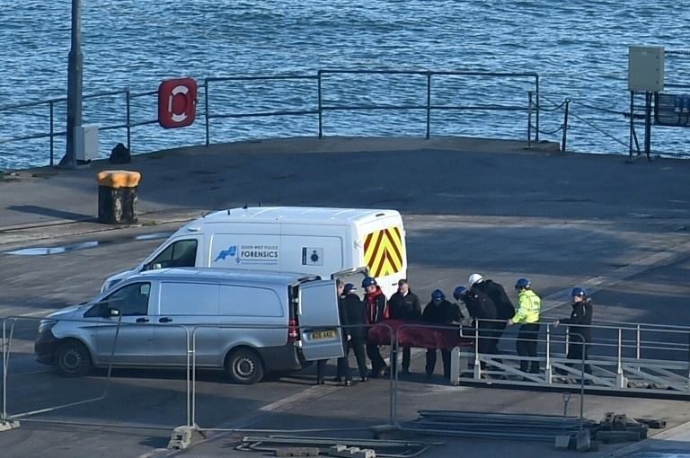The body was brought ashore after being recovered from the underwater wreckage of the plane which disappeared near Guernsey on January 21. — AFP
