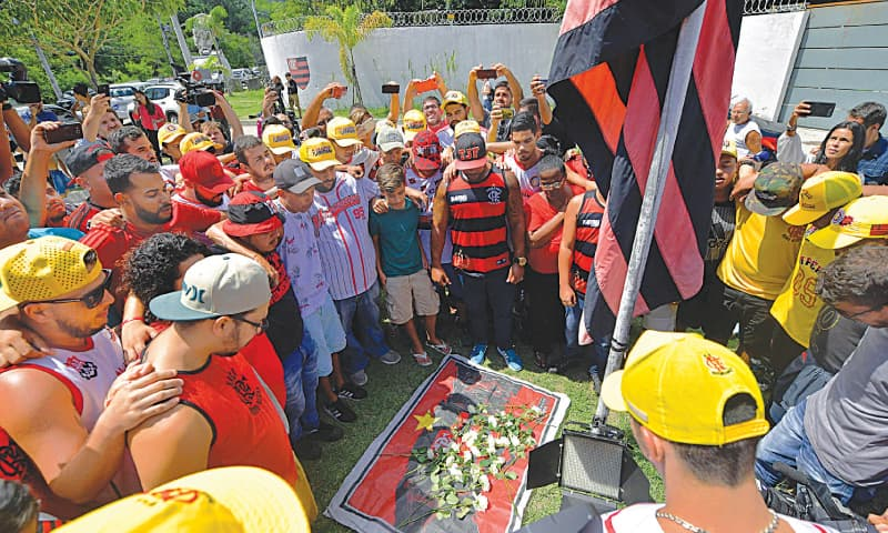 Rio de Janeiro: Brazilian football club Flamengo fans lay flowers at the entrance to the club's training centre after the deadly fire.—AFP