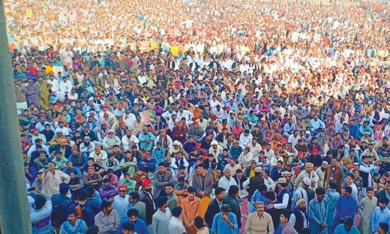 PEOPLE listen to Federal Minister Chaudhry Ghulam Sarwar at a public meeting organised by independent MNA Syed Ali Nawaz Shah at Gama Stadium in Mirpurkhas on Saturday.—Dawn