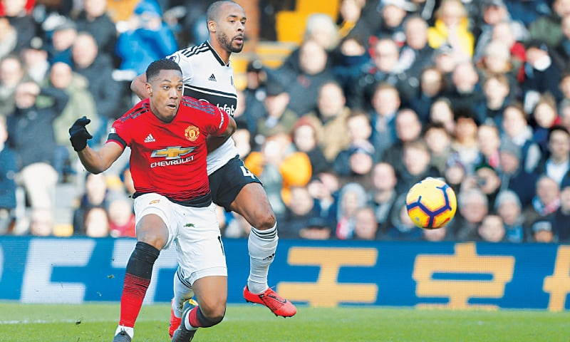 LONDON: Manchester United's Anthony Martial (L) shoots to score during the Premier League match against Fulham at Craven Cottage on Saturday.—AFP