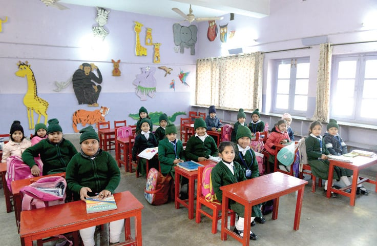 Nursery students attend class. — Photos by Mohammad Asim