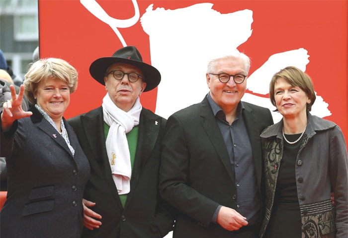 From left, Monika Gruetters, Federal Government Commissioner for Culture and the Media, festival director Dieter Kosslick, German President Frank-Walter Steinmeier and his wife Elke Buedenbender pose for the media on the red carpet for the film 'Brecht' at the 2019 Berlinale Film Festival on Saturday.—AP