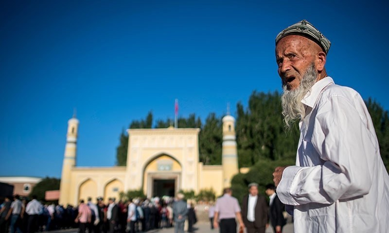 This picture taken on June 26, 2017 shows a Muslim man arriving at the Id Kah Mosque for the morning prayer on Eid al-Fitr in the old town of Kashgar in China's Xinjiang Uighur Autonomous Region. — AFP/File