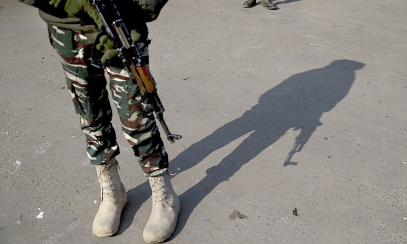 In this Feb 3, 2019 file photo, a shadow of an Indian paramilitary soldier is cast as he stands guard at a temporary checkpoint during a strike in Srinagar, Indian occupied Kashmir. — AP