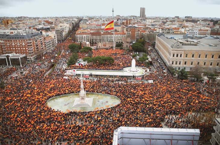 Madrid: Thousands of demonstrators hold Spanish flags during a protest on Sunday called by right-wing political parties to demand that Socialist Prime Minister Pedro Sanchez step down.—AP
