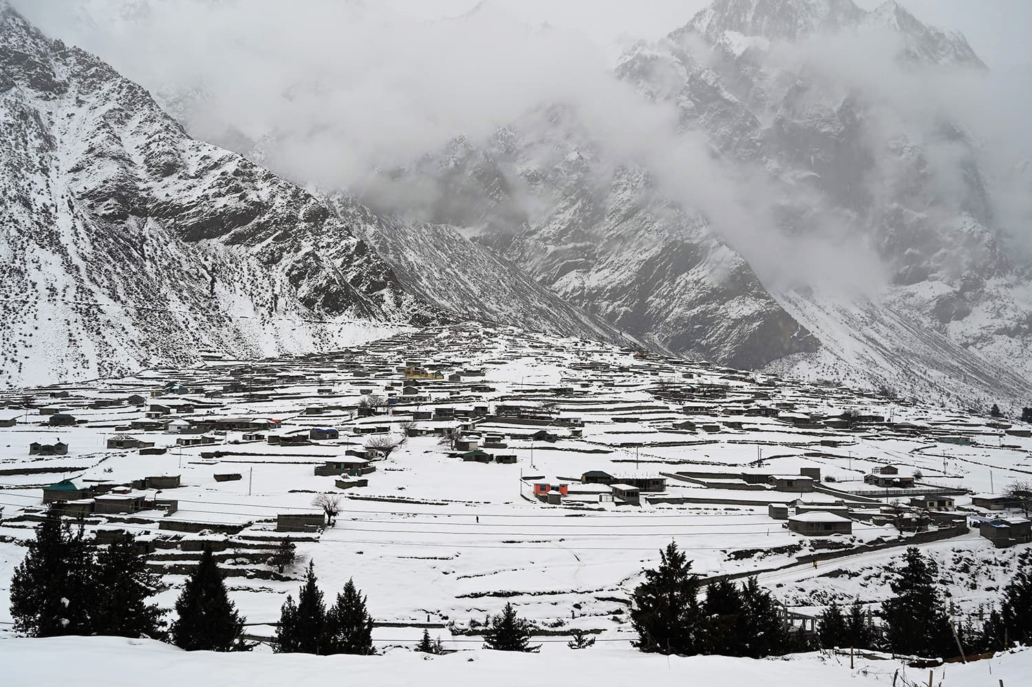 A general view of the snow-covered homes in the Naltar Valley. ─ AFP