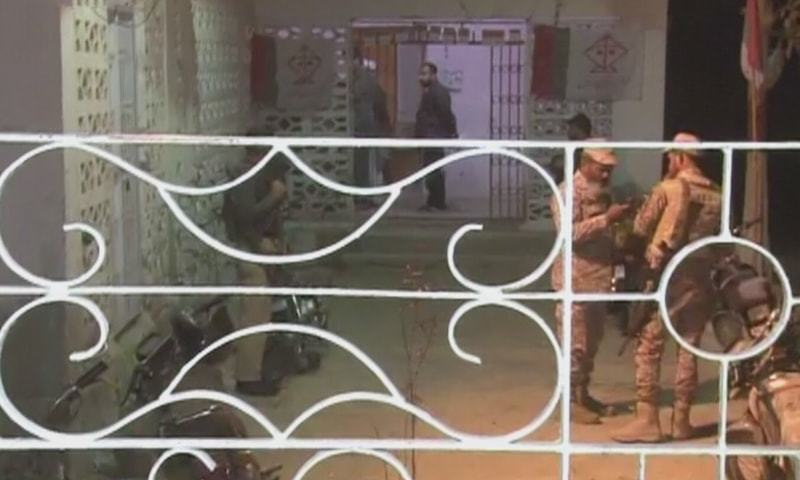 Security personnel are seen outside the UC office in New Karachi which came under attack on Monday. — DawnNewsTV