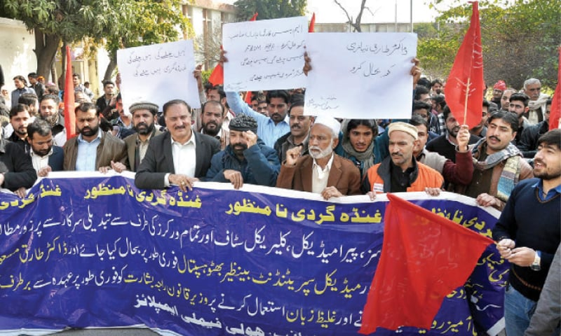 Doctors and paramedical staff raise slogans during their protest on Monday. — Online