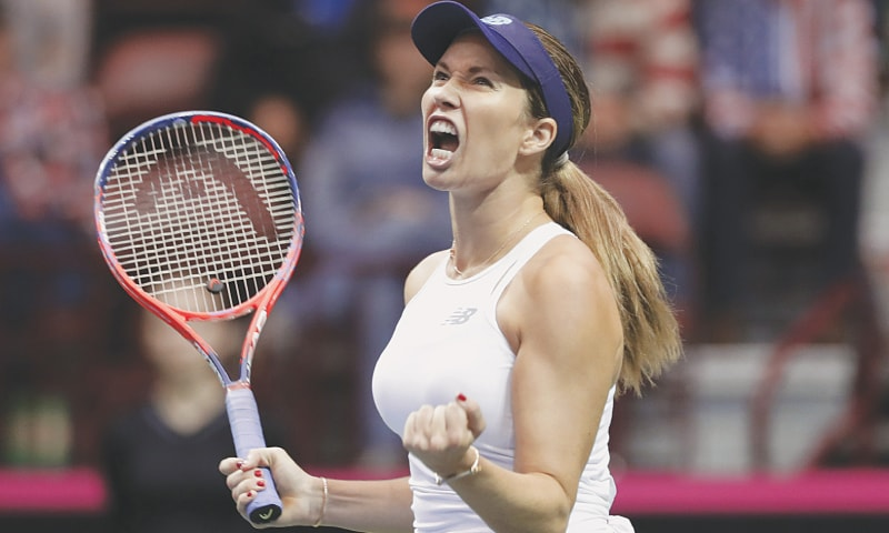ASHEVILLE (North Carolina): Danielle Collins of the US reacts after winning a point against Australia's Daria Gavrilova during their Fed Cup match.—AP
