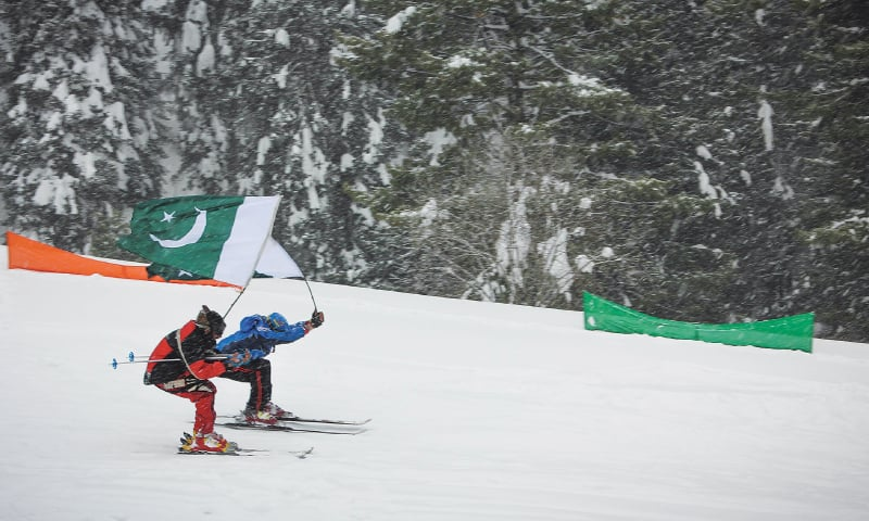 Players ski down the 9,000-foot-high slope during a competition in Malam Jabba on Monday.—Dawn