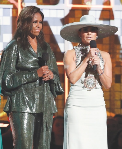 Los Angeles: Former American first lady Michelle Obama (left) stands beside Jennifer Lopez at the Grammy Awards ceremony on Sunday.—AP