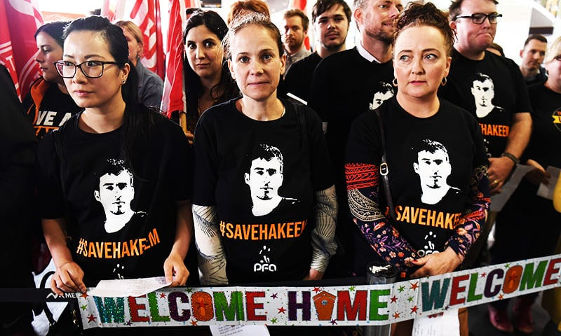 Supporters of refugee footballer Hakeem al-Araibi wait for his arrival at the airport in Melbourne.— AFP