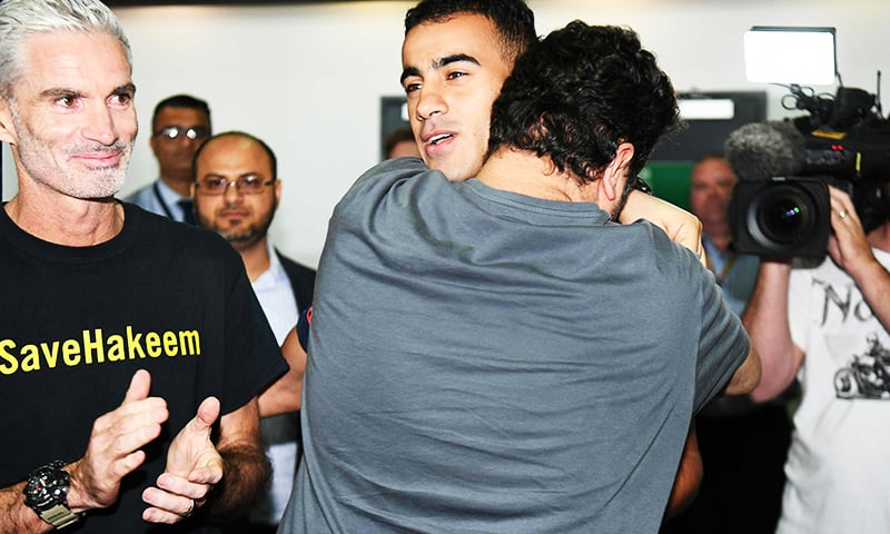 A supporter hugs footballer Hakeem al-Araibi at the airport in Melbourne.—AFP