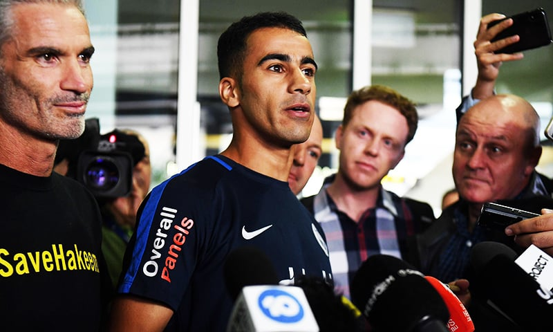 Footballer Hakeem al-Araibi speaks to the media beside ex-Socceroos captain Craig Foster upon his arrival at the airport in Melbourne.— AFP