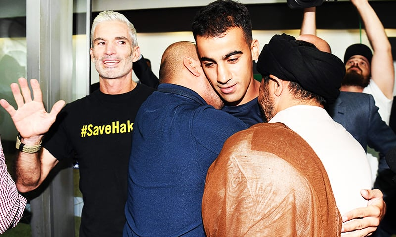 Supporters receive footballer Hakeem al-Araibi upon his arrival at the airport in Melbourne.— AFP