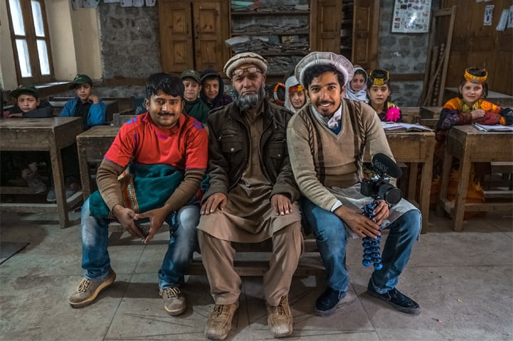Mooroo (R) and his loveable sidekick Ahsan Ahmed (L) with a school teacher in Kalash Valley