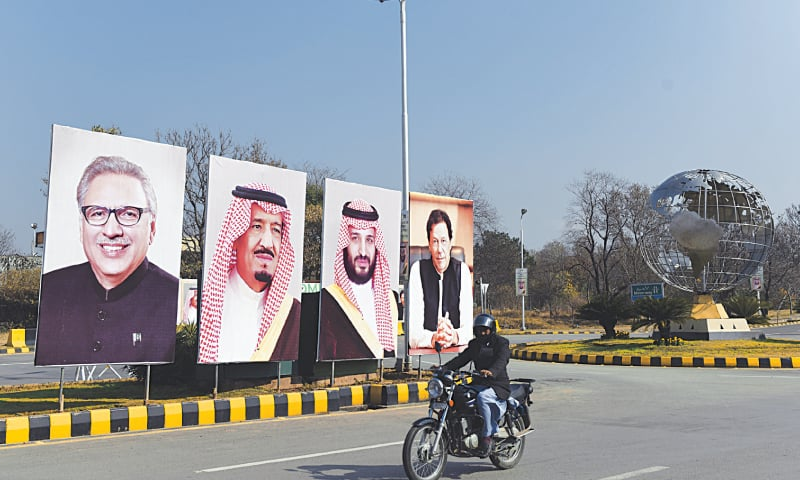 ISLAMABAD: Billboards showing portraits of President Arif Alvi, King Salman of Saudi Arabia, Crown Prince Mohammad bin Salman and Prime Minister Imran Khan adorn a road on Friday as authorities prepare to welcome the crown prince, who is due on Sunday.—Tanveer Shahzad / White Star