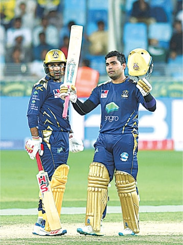 DUBAI: Umar Akmal of Quetta Gladiators acknowledges the cheers of the crowd after completing his half century.