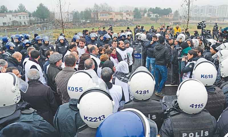 Diyarbakir: Turkish anti-riot police surround and block members of the pro-Kurdish Peoples Democratic Party during a demonstration on Friday in solidarity with a lawmaker on hunger strike.—AFP