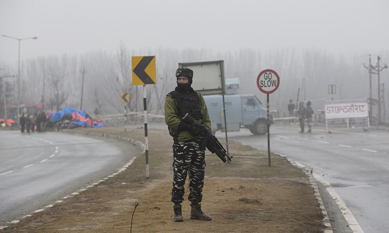 An Indian paramilitary soldier stands guard near the site of Thursday's explosion in Pampore, Indian-occupied Kashmir. — AP