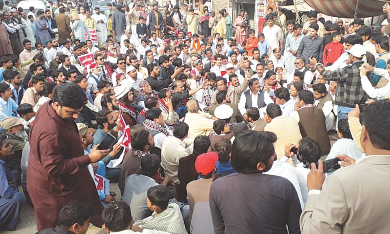 PEOPLE from different walks of life hold a rally in Naudero on Saturday to condemn recent killings in Sindh.—Dawn