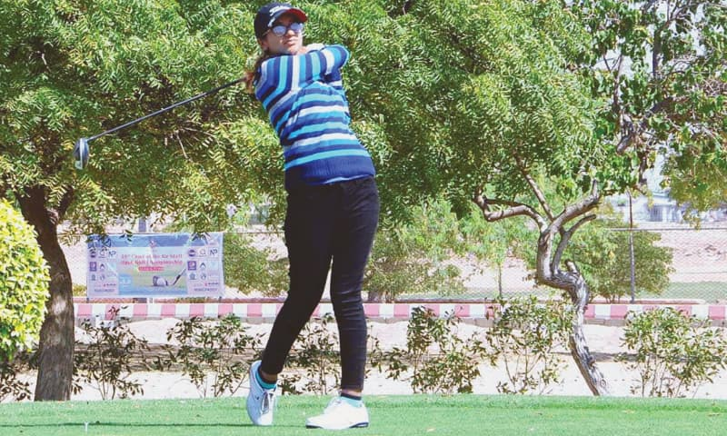 KARACHI: Amna Amjad tees off during the CAS Open Golf Championship at Airmen Golf Course on Saturday.—APP