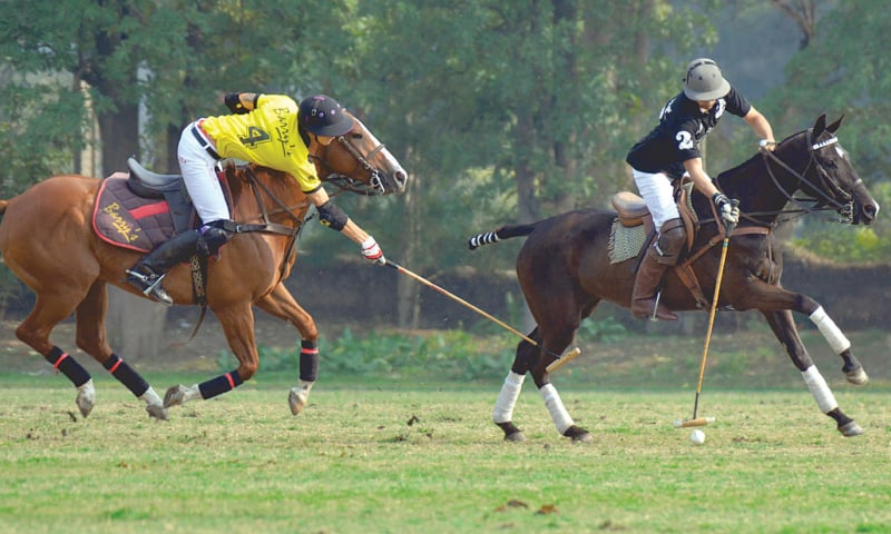 LAHORE: Players of Master Paints Black and Barry`s vie for the ball during their Hamadan Aibak Polo Cup match at the Lahore Polo Club on Saturday.—M Arif/ White Star