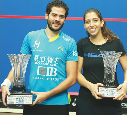 Winners of the Pakistan Open Squash Championships Karim Abdel Gawad and Yathreb Adel, both from Egypt with their trophies