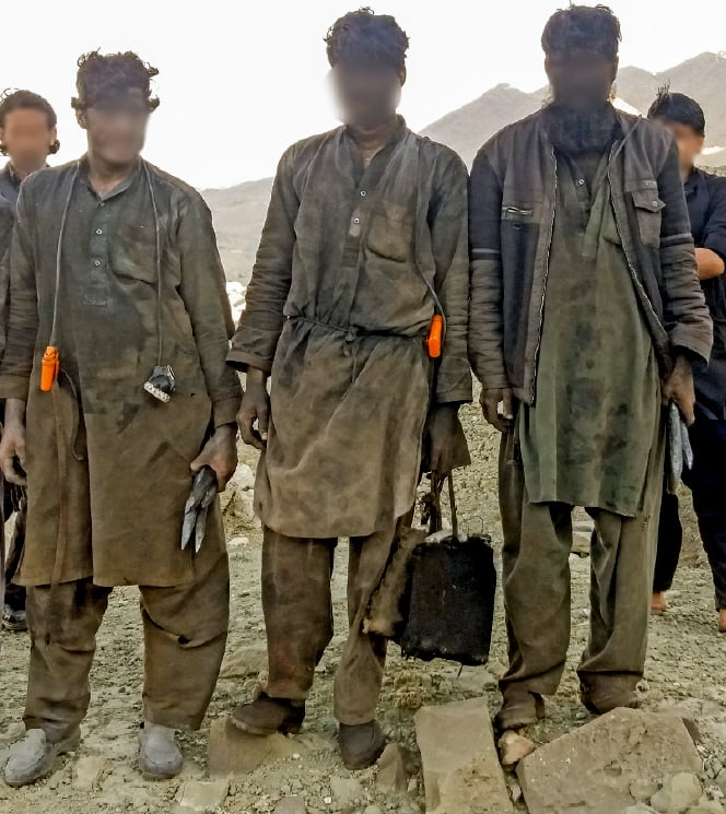 Miners return from their shift. ─ Photo by author