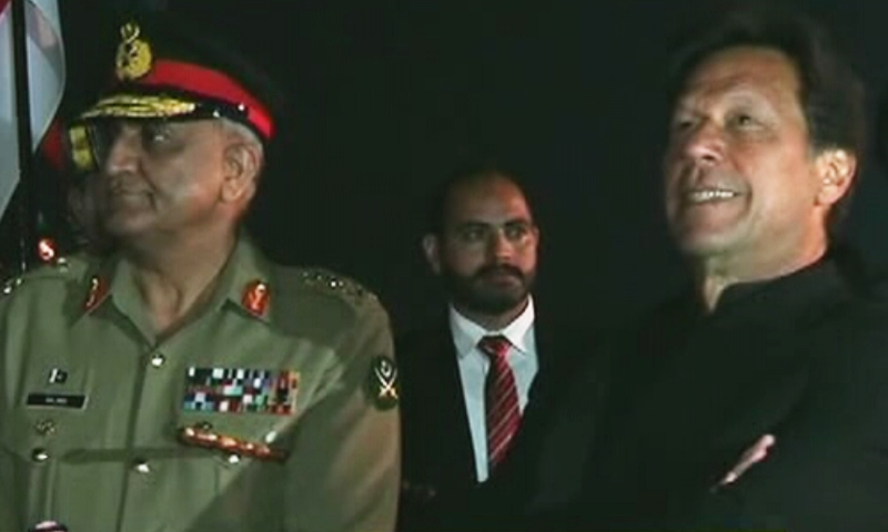 PM Imran Khan and Army Chief Gen Qamar Bajwa await to receive MBS. — DawnNewsTV