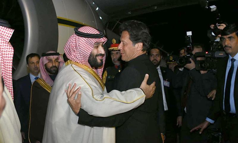 Prime Minister Imran Khan greets Saudi Crown Prince Mohammad bin Salman upon his arrival at Nur Khan Air Base. — Photo courtesy: Arab News