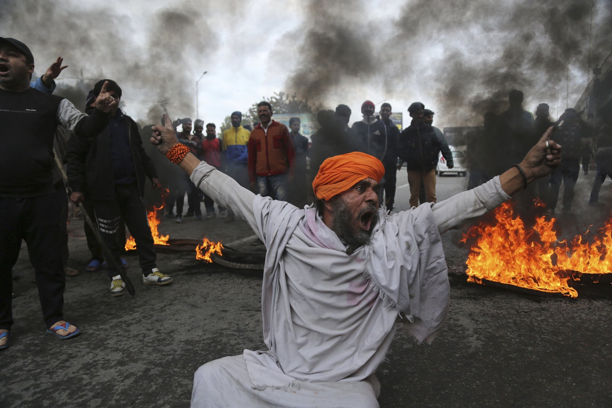 A protestor shouts slogans against the attack on a paramilitary convoy in Pulwama. — AP