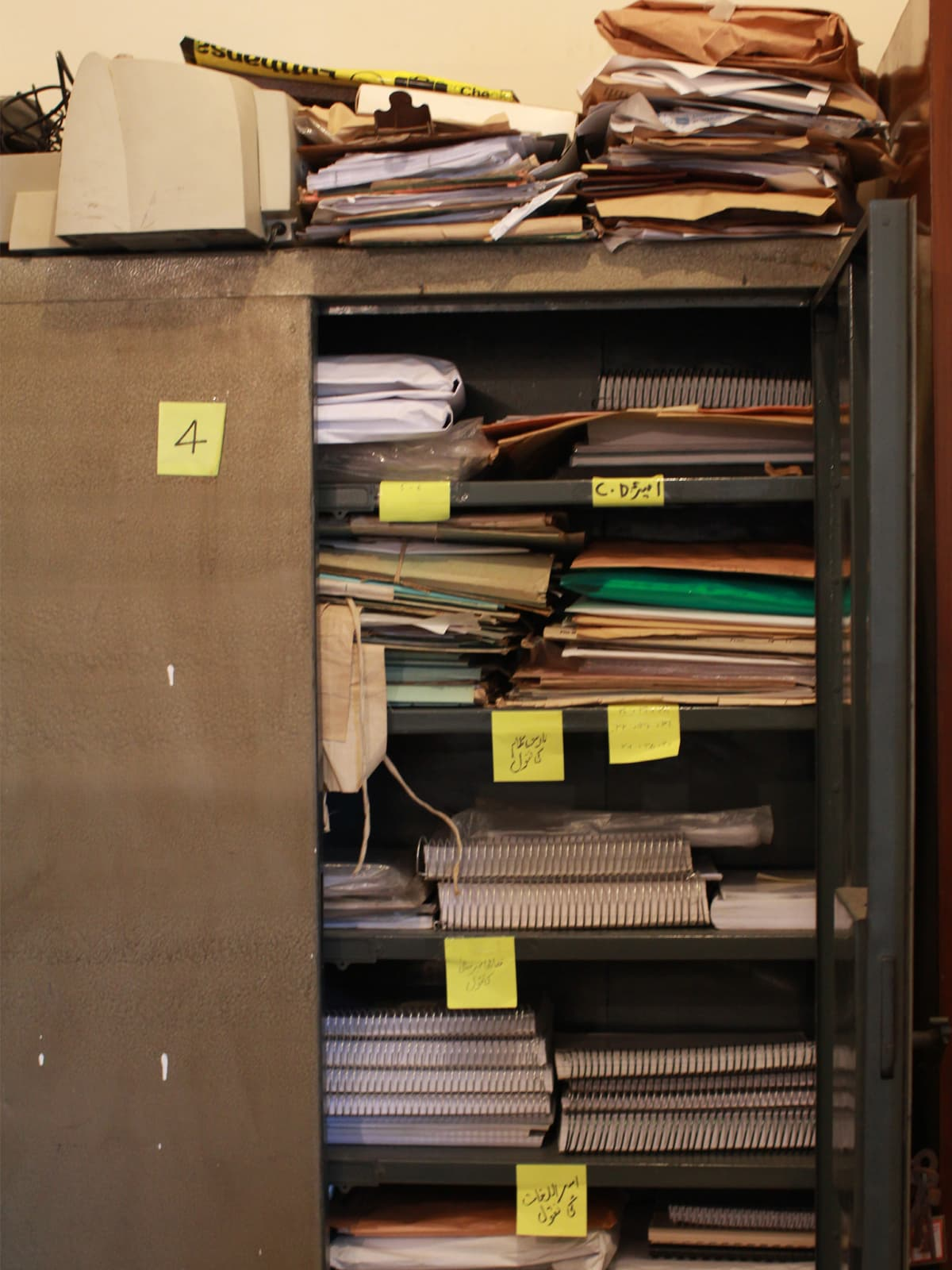 A metal cupboard containing some of Ameer Minai's works