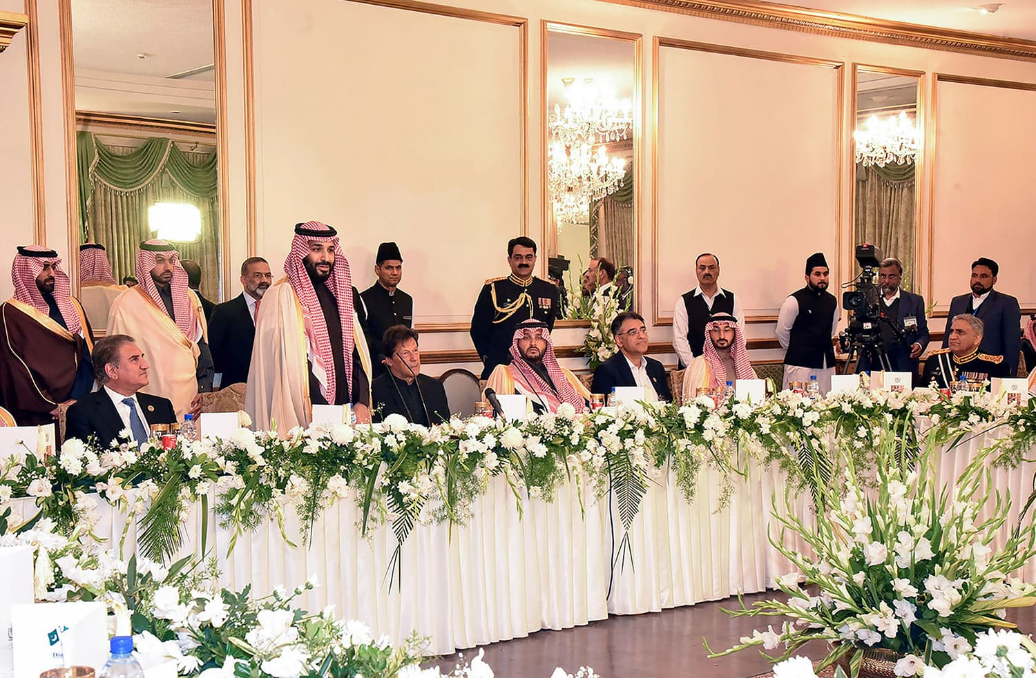 Crown Prince Mohammed bin Salman speaks next to Prime Minister Imran Khan during a reception at the Prime Minister House in Islamabad. — AFP