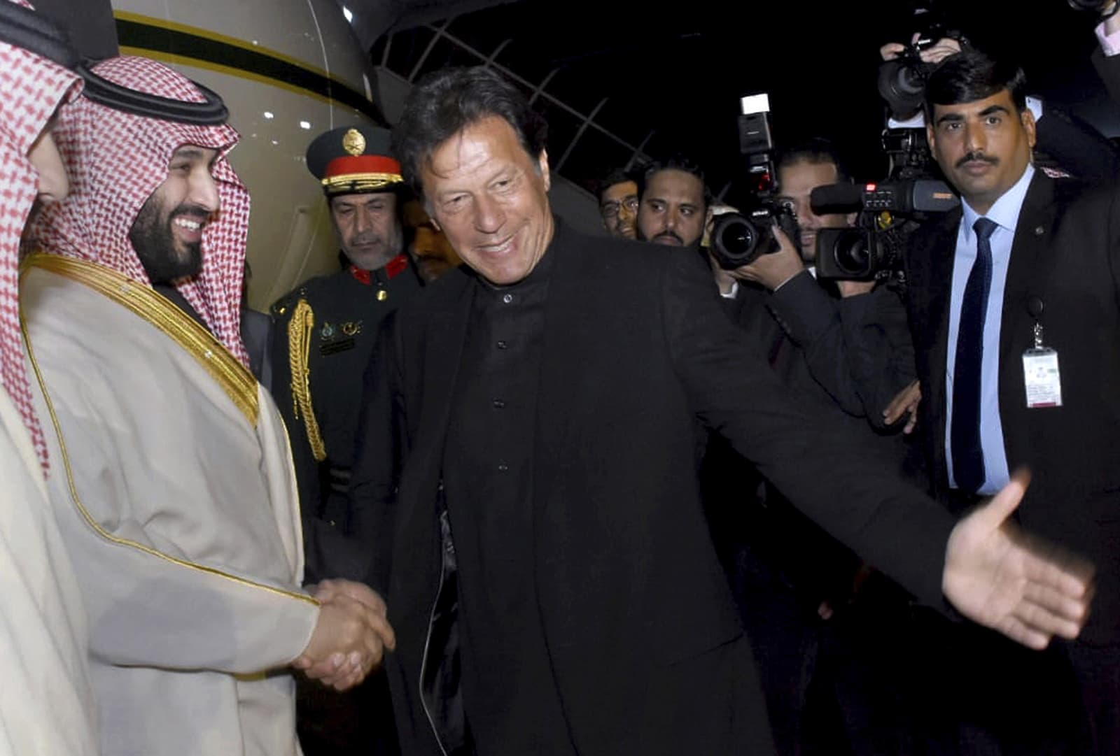 Prime Minister Imran Khan greets Saudi Arabia's Crown Prince Mohammed bin Salman upon his arrival at Nur Khan Airbase in Rawalpindi on Sunday. — AP