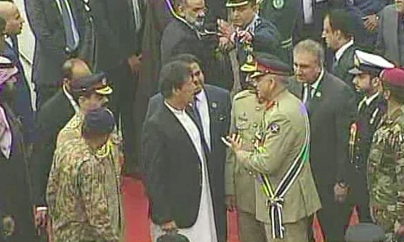 Prime Minister Imran Khan and COAS Gen Qamar Javed Bajwa confer after the crown prince departs. ─ DawnNewsTV