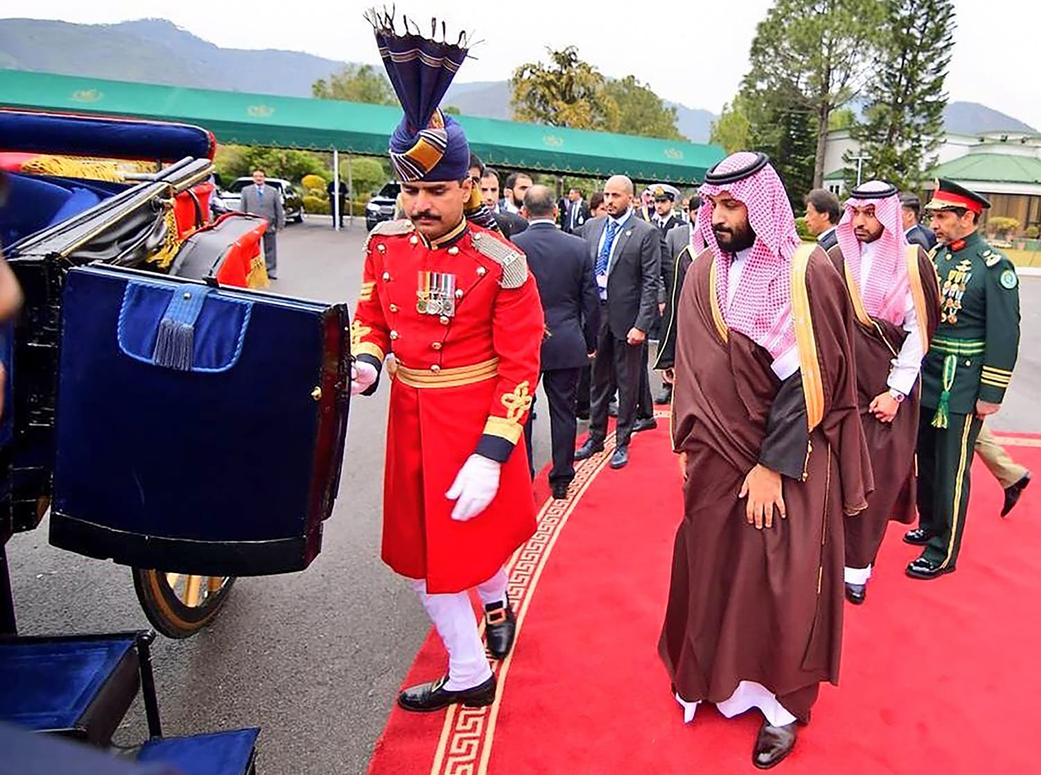 Crown Prince Mohammed bin Salman gets on a horse-drawn carriage to proceed to the President House in Islamabad on Sunday. —AFP