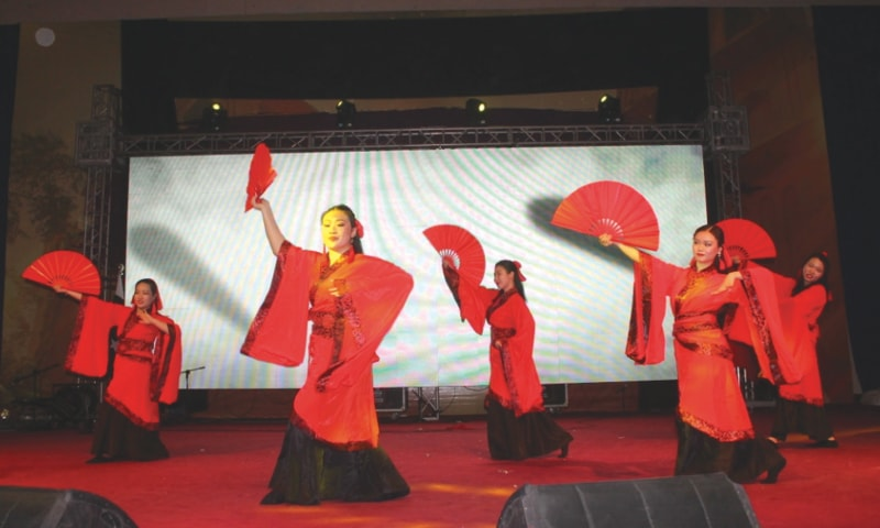 A CHINESE troupe performs at the Pak-China Cultural Caravan held at the Sindh University in Jamshoro on Monday.—Dawn