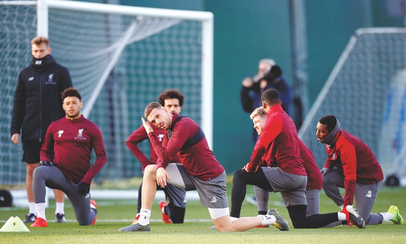 LIVERPOOL: Liverpool players stretch during a training session on Monday.—Reuters