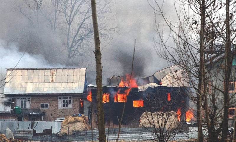 A HOUSE in Pulwama in which Kashmiri fighters were suspected to have sheltered is in flames after the gunfight on Monday.—AFP