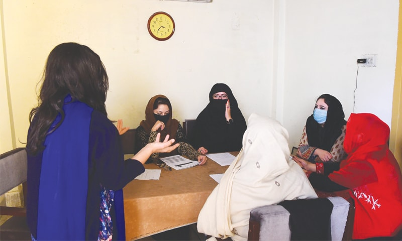 PESHAWAR: In this picture taken on Dec 17, 2018, Ayeesha (left), an employee of the NGO Aware Girls, briefs other employees on how to treat and answer  calls on the hotline 'Sahailee' ('friend') dedicated to abortion.—AFP