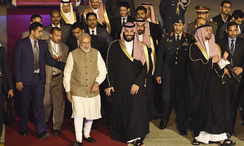 Saudi Crown Prince Mohammed Bin Salman walks next to Indian Prime Minister Narendra Modi upon arriving at the airport in New Delhi on February 19, 2019. — AFP