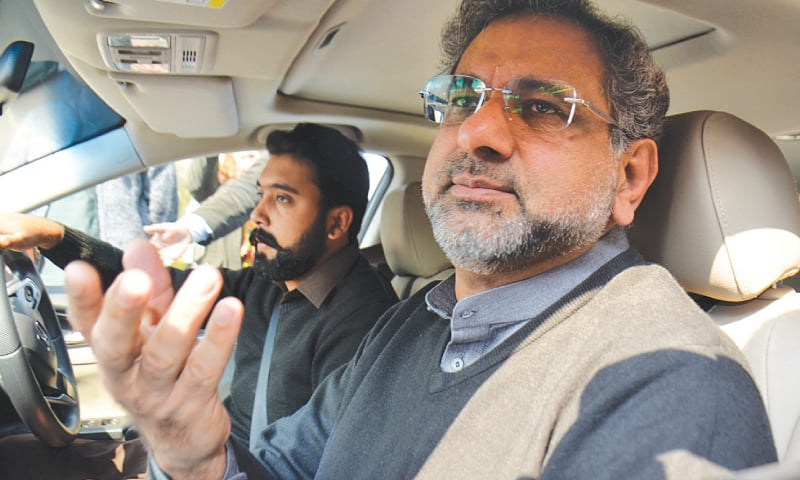 FORMER prime minister Shahid Khaqan Abbasi leaves NAB's regional office after recording his statement in the LNG import case.—Tanveer Shahzad / White Star