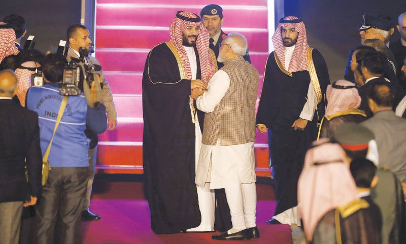 NEW DELHI: Indian Prime Minister Narendra Modi (right) talks to Saudi Crown Prince Mohammed bin Salman upon his arrival at the airport on Tuesday.—Reuters