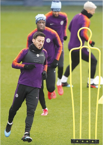MANCHESTER: Manchester City's David Silva (L) and team-mates are engaged in exercises during a training session at the City Football Academy on Tuesday.—AP