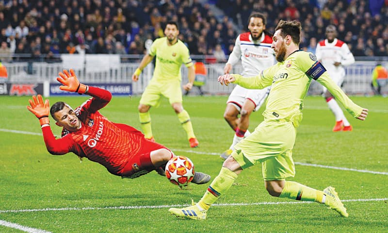 LYON: Olympique Lyonnais' goalkeeper Anthony Lopes saves a shot from Barcelona's Lionel Messi during their UEFA Champions League round-of-16 first leg at the Groupama Stadium.—Reuters