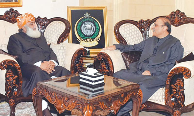 ASIF Ali Zardari in conversation with JUI-F chief Maulana Fazlur Rehman at the latter's residence.—White Star