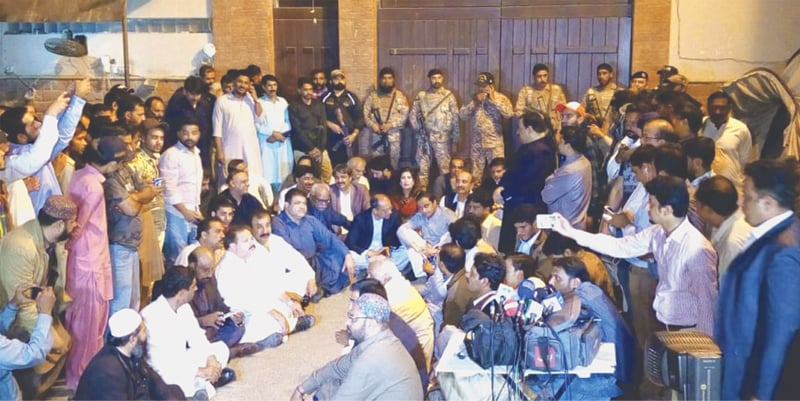 KARACHI: PPP leaders and workers protest outside the house of Agha Siraj Durrani against his arrest. The party leaders were particularly angry over denial of permission to female ministers to meet Mr Durrani's family in the house after it was raided by a NAB team.—Shakil Adil / White Star