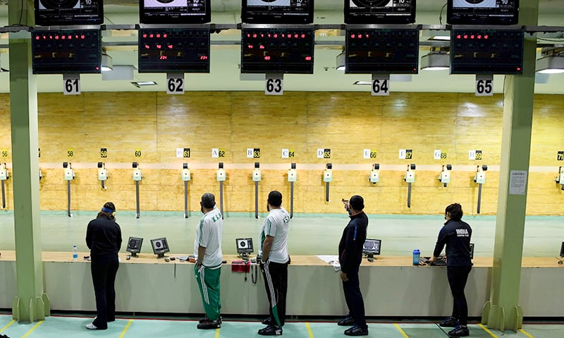 Shooters from different participating countries take part in a practice session with air pistols at the International Shooting Sport Federation (ISSF) World Cup at Dr. Karni Singh Shooting Range, in New Delhi. ─ AFP
